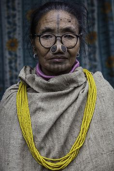 Woman from Apatani tribe, Arunachal Pradesh. Ahhhh! How is she breathing???