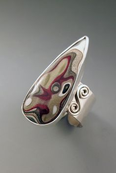Ring | Patti West. Sterling silver and Fordite / Detroit Agate.