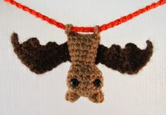 "This tiny bat, just 2"" tall, has loops for feet so you can hang him upside down wherever you like."