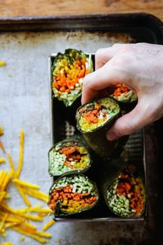 RAWSOME WRAPS: spinach tortillas filled with mashed avocado and shredded veggies