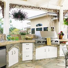 Love this stone outdoor kitchen