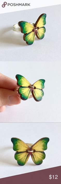"Green & Yellow Butterfly Button Ring - Handmade A colorful butterfly wrapped with silver plated, tarnish-resistant wire. Very cute and vibrant. The perfect gift for a nature lover. The button is made of wood and glazed for a shiny finish. Butterfly is about 1"" wide. Made to order, actual item may vary slightly. New and never worn. Not intended for children under 12. Currently 4 available. Jewelry Rings"