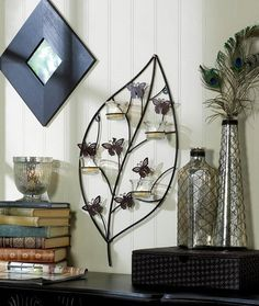 BOUNCY BUTTERFLY CANDLE SCONCE. Starting at $15 on Tophatter.com!