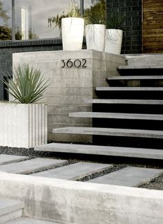 Floating concrete treads + house numbers.