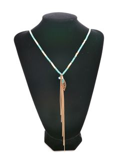 "This gorgeous ""On A Whim Necklace"" is just too cute with its turquoise beading & gold tassel fringe & adorable feather charm!!"