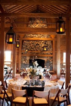 Indoor Reception Ideas: Lodge-style cabin, floor-to-ceiling rock fireplace. Gives a cozy, welcoming feel to a small party.