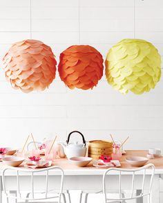 NOTE TO SELF: Instead of spending $$$ on the mother-of-pearl chandelier, why not make this one, only with white tissue paper? Martha Stewart's version is sooo much more affordable, and every bit as cool.