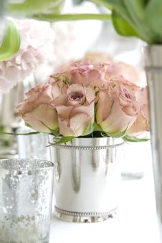 #Roses in a silver bucket....I'm hoping Kaia would like a tea party birthday party one day.