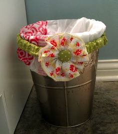 Garbage Can Bag Holder Tutorial - Have fun dressing up your trash cans.