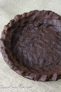 This chocolate pie crust is nut free, grain free, low carb and sugar free! It's the most perfect allergy friendly pie crust!