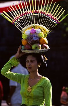 Balinese woman with Temple Offering ❀  Bali Floating Leaf Eco-Retreat ❀ http://balifloatingleaf.com ❀