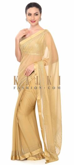 Buy this Beige saree highlighted in kundan border only on Kalki