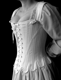 This 18th century corset is rigidly boned with closely spaced 1/4 steel bones and is cut to enhance and lift the bust, and shape the waist. The