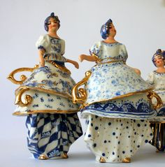 Dancers in combination with small teacups. My ceramic work. Dance in blue and white. And Gold