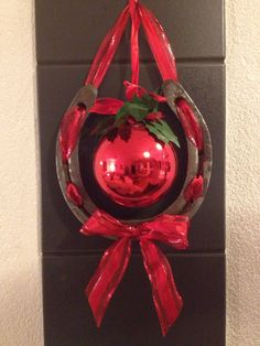 """Recycling of horse shoes :-) Christmas Gift!! Instead of a christmas ball use a glittery or shiny """"A"""" for Anderson to hang on the door or wall."""