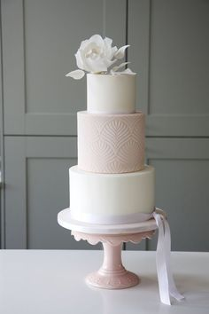 Three tier wedding cake, with sugar whimsical rose on top, natural stencil design on the middle tier. Elizabeth Harris is a cake designer based in the North West, get in contact to book a consultation. Wedding Cake Base, Blush Wedding Cakes, 3 Tier Wedding Cakes, Floral Wedding Cakes, Fall Wedding Cakes, Beautiful Wedding Cakes, Wedding Cake Designs, Wedding Cake Toppers, Mauve Wedding
