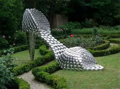 Joana Vasconcelos, made from ordinary steel pans and lids www.travers.com