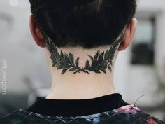 Laurel wreath tattoo on the back of the neck.