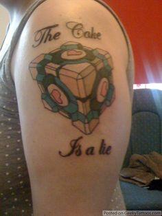 """Jemma's """"The Cake is a Lie"""" Tattoo @ Geeky Tattoos Fandom Tattoos, Companion Cube, Dinosaur Tattoos, Kid Ink, Tattoo Videos, Body Mods, Tattoo Inspiration, Portal, Geek Stuff"""