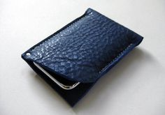 Perfectly sized for your iPhone, this case is crafted from gorgeous, thick, textured indigo blue bull leather. The case features a raw leather edge and corner rivet detail.  From Fog + Foundry. $30