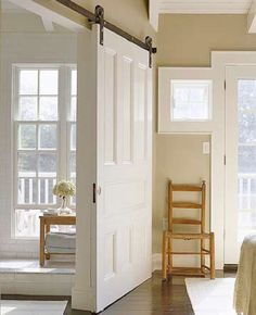 Sliding Barn Door This door isn't just a door--it also functions as a wall. The white doors are hung on barn door rollers and are easy to slide open and closed. Could be used between the living room and kitchen diner. Barn Door Rollers, Interior Sliding Barn Doors, Sliding Doors, Barn Door Designs, Door Design Interior, Interior Ideas, Interior Inspiration, The Doors, Entry Doors