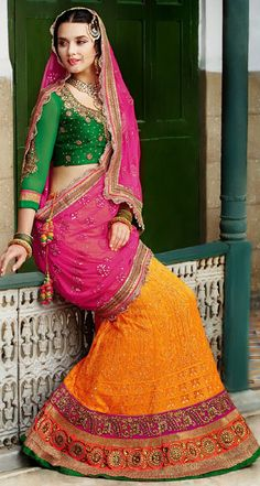 Golden And Hot Pink Designer Wedding Lehenga Choli Is Designed Net With Embroidery And Mirror Work Lehenga And Green Embroidery And Stone Work Blouse.Available With Matching Hot Pink Net With Stone And Embroidery Lace Work Dupatta. Wedding Chaniya Choli, Ghagra Choli, Indian Wedding Outfits, Indian Outfits, Mirror Work Lehenga, Net Lehenga, Lehenga Blouse, Indian Clothes Online, Indian Bridal Lehenga