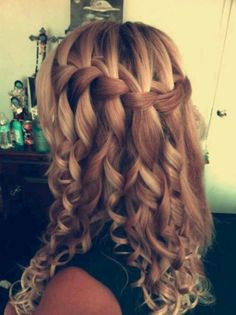 Waterfall braid...curled! Genius...I should get my hair done like this for my mom's wedding