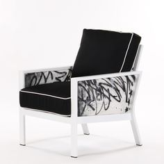 Designed by Chris Panichella with a sturdy aluminum frame and cushions upholstered in water-resistant Sunbrella acrylic fabric, the big, bold Graffiti Club Chair is not your grandmother's seat. This one-of-a-kind piece is painted by graffiti artist George SEN One Morillo. Pairing clean lines with a vibrant, energetic, street-inspired finish, this Koverton design brings a little urban flavor to your space.