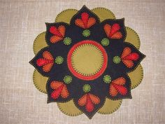 Penny Rug fall candle mat