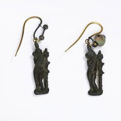 Pair of earrings      Place of origin:    Egypt (possibly, made)   Europe (possibly, made)      Date:    1st century (made)      Artist/Maker:    Unknown (production)      Materials and Techniques:    Gold, hung with bronze figure - V & A