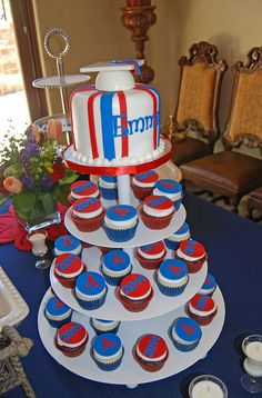 Red and blue graduation cupcake tower by Simply Sweets.