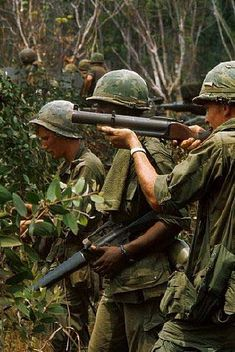 Group of American soldiers in the jungles of Vietnam. The first carries a M-79 grenade launcher.