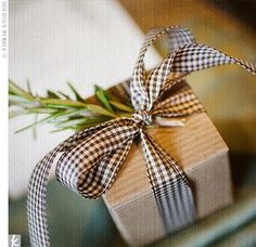 I love this wrapping color scheme... gingham ribbon, kraft paper and rosemary or a christmas tree sprig