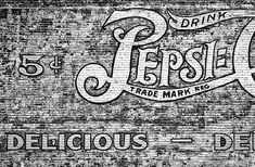 Photograph by Stuart Litoff.  A black and white #photo of part of a large #PepsiCola #ghost #sign painted on an outside #brick #wall in $Roanoke, #Virginia.