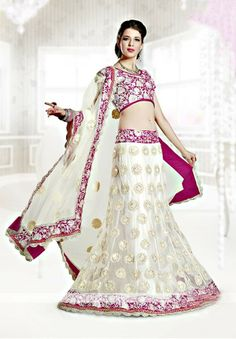JAG FOX Manifest glamour in this elegant cream net A-line lehenga choli. The crystals encompassed in resham embroidered motifs add simple elegance. Applique worked border beside bead enhanced border and scallop hemline aggrandize the ensemble. Comes with a matching choli and dupatta.Product Featureswork: Embroidered, Hand WorkStyle: A - Lineoccasion: Wedding, Bridal, Receptionfabric: Netcolor: Cream [Rs13,746.00]