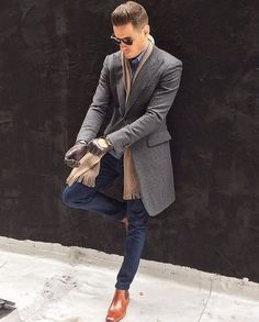Awesome Brown chelsea boots gray jacket tan scarf sunglasses chocolate colored leather gloves and plaid oxford shirt. Nice winter combo. #winterfashion #winteroutfits #menswear #mensfashion #menstyle