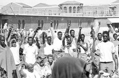 Inmates at Attica State Prison in Attica, N.Y., raise their hands in clenched fists in a show of unity during the Attica uprising in this photo from Sept. 1, 1971.