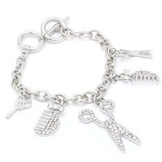 """This toggle-clasp charm bracelet is adorned with 3 sets of miniature scissors, a hair comb, and a hair brush. The miniature accessories are adorned with crystal studs and have texture. The charm bracelet is metal casting with a 2 1/2"""" drop. Size: 8 1/2"""" Long 