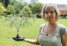 Castle Green Art Glass offers beaded wire tree and flower sculptures Tuesdays at Congress Park in Saratoga Springs. (LAUREN HALLIGAN/photos@saratogian.com)