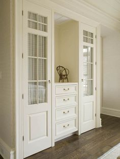 closets with a dresser & mirror between.