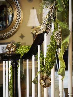 Traditional greenery with contemporary metallic ornaments and apple-green ribbon. http://www.hgtv.com/decorating-basics/our-favorite-christmas-decorating-ideas/pictures/page-3.html?soc=pinterest