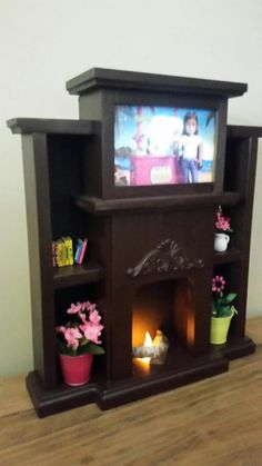 American Girl doll sized entertainment center flickering Fireplace , LIGHTED TV, fish tank, in one, espresso-for dolls Doll House Crafts, Doll Home, Barbie Doll House, Doll Crafts, Diy Doll, American Girl House, American Girl Crafts, American Girl Clothes, My American Girl Doll