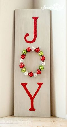 How to make this DIY wooden joy sign for your front door or your home. With this simple kit, you can create your own DIY wooden joy sign to decorate your front door or home. Christmas Decorations For Kids, Christmas Projects, Holiday Crafts, Holiday Fun, Christmas Ornaments, Christmas Ideas, Holiday Ideas, Wooden Christmas Crafts, Christmas Cactus