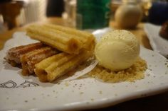 Churros filled with dulce de leche with banana ice cream at DOA Miami, a rave review for restaurant. www.miamicurated.com