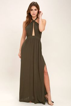 All eyes will be on you in the Watch Me Olive Green Maxi Dress! Gauzy rayon drapes into a halter bodice with adjustable strap that loops through a keyhole at the neck, and ties at back. A fitted waistline accentuates your figure before flowing into a full, maxi skirt with sexy side slit. Side seam pockets. Hidden back zipper/clasp.