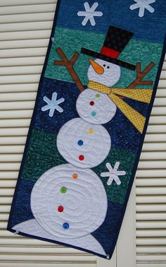 whimsical snowman Table Scarf. The two tall snowmen have long gold scarves around their necks, and tall black top hats, and they are ready to dance around.