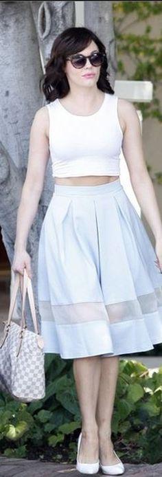 White print handbag and blue skirt