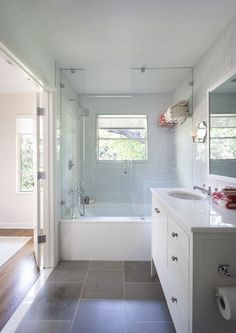 big bath/shower combo that works. Takes up less space and leaves more room for closets. :) Add 2 small farmhouse vanities.