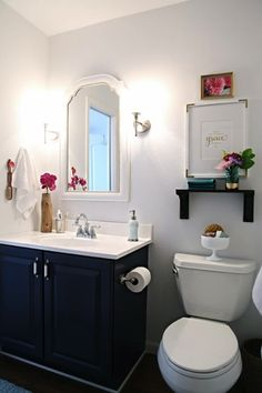 bathroom makeover - love the dark navy cabinets with white counter top