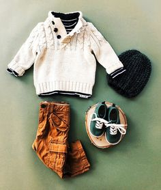 wear: little cable sweaters layer over a striped tee and pair with a chunky beanie and cozy sneakers for a day of exploring.